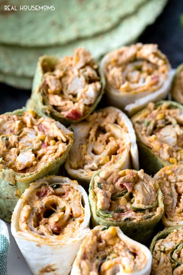 Spicy Chicken Tortilla Roll Ups are full of amazing flavors perfect for any party! These easy chicken pinwheels can be made ahead of time & served up later!