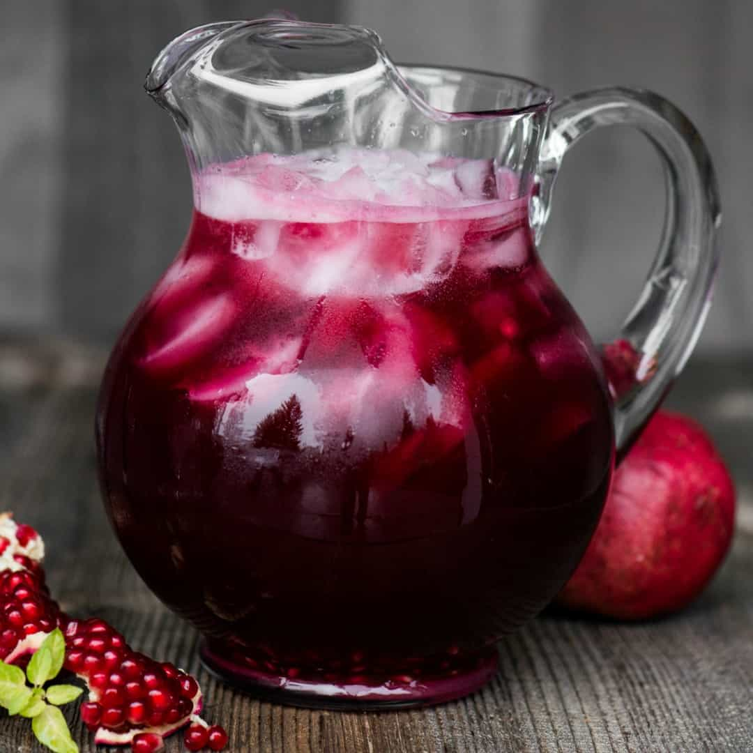 Spiked Pomegranate Punch with vodka and prosecco, is a festive and easy to make sparkling punch that is perfect for any holiday party!