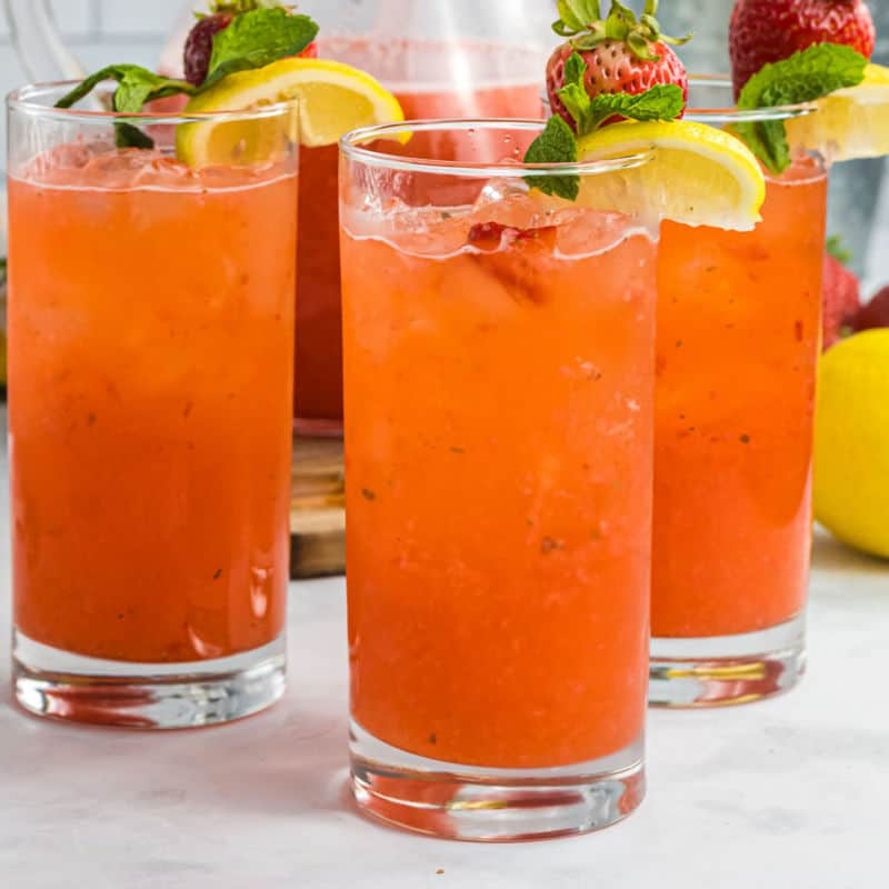 tall glasses with spiked strawberry lemonade
