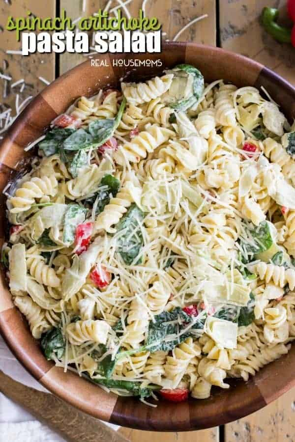 This Spinach Artichoke Pasta Salad is a fast and delicious pasta dish that can be assembled in a matter of moments and is sure to wow at your next potluck or party!