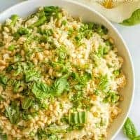 One-pot spring rice pilaf with asparagus and peas is a bright, fresh and easy side dish that's topped with Parmesan cheese, fresh basil & pine nuts!