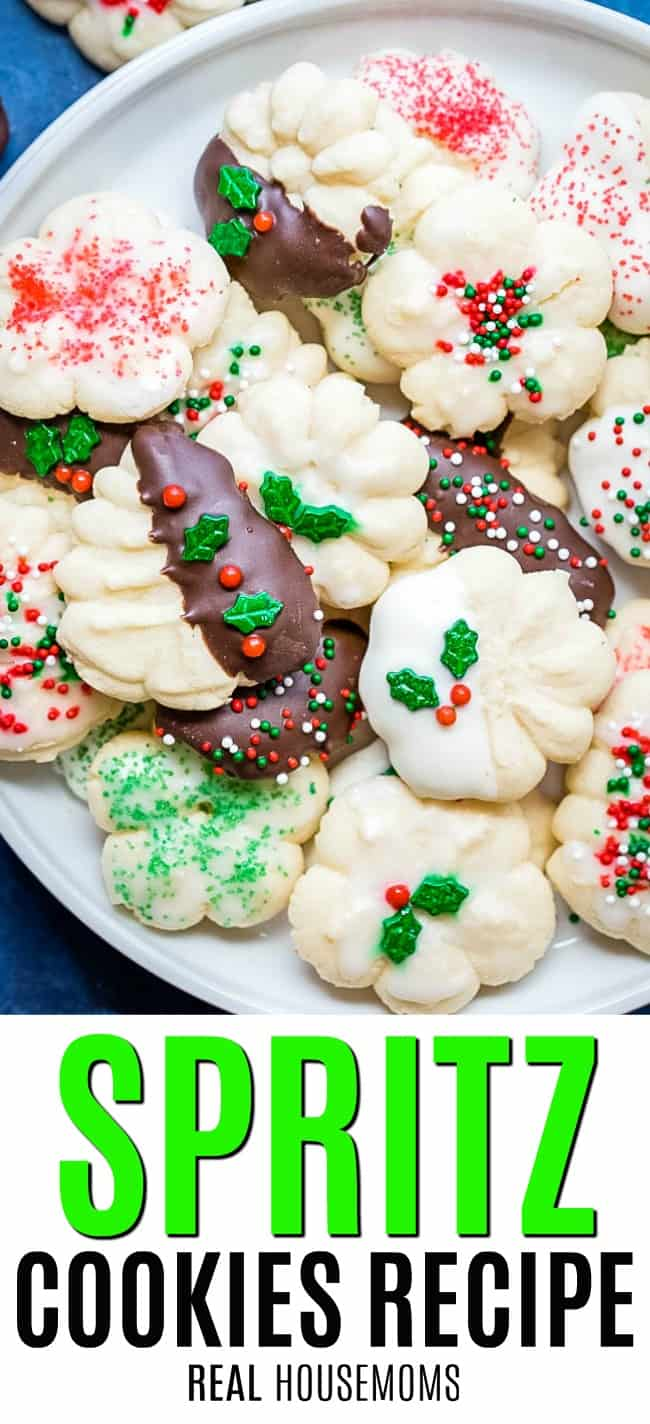 spritz cookies decorated and piled on a plate