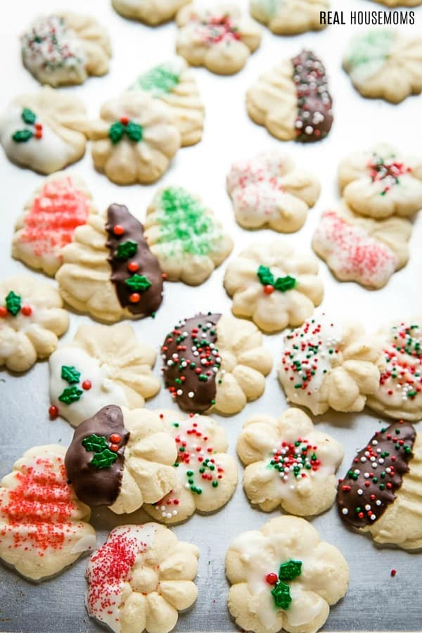 spritz cookies on a baking sheet after being decorated