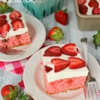 This STRAWBERRIES AND CREAM POKE CAKE is the most amazing strawberry cake, ever! Perfect anytime you're in the mood for a delicious berry dessert!