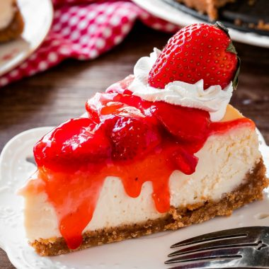Everyone goes crazy for this strawberry cheesecake recipe! It's extra creamy with a crunchy graham cracker crust and juicy strawberry topping!