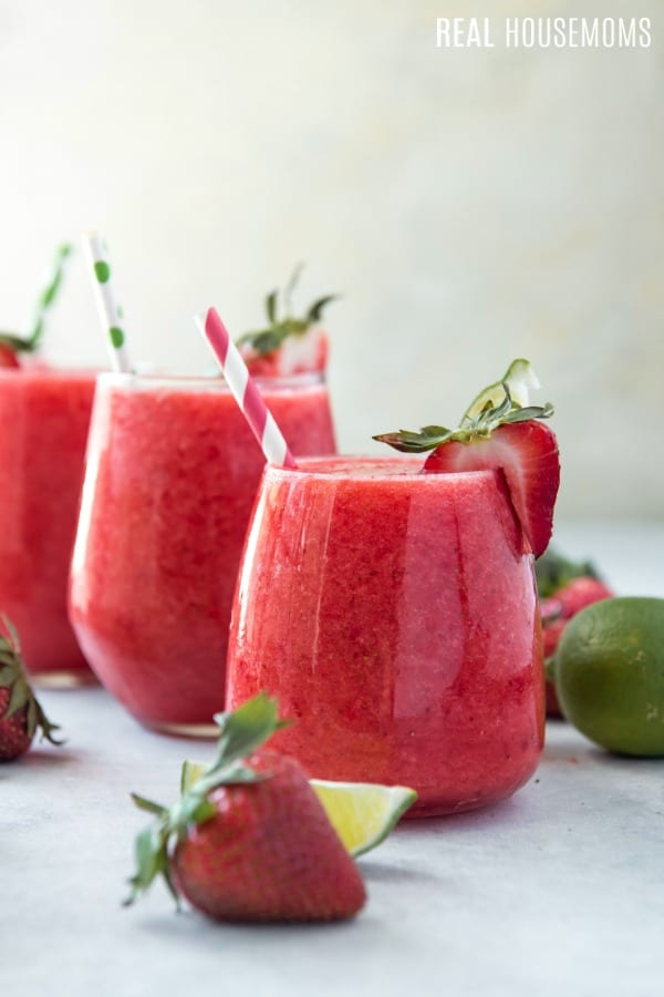 strawberry & lime moscato wine slushie in cocktail glasses with straws