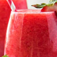 Close up image of a glass of strawberry lime moscato wine slushie
