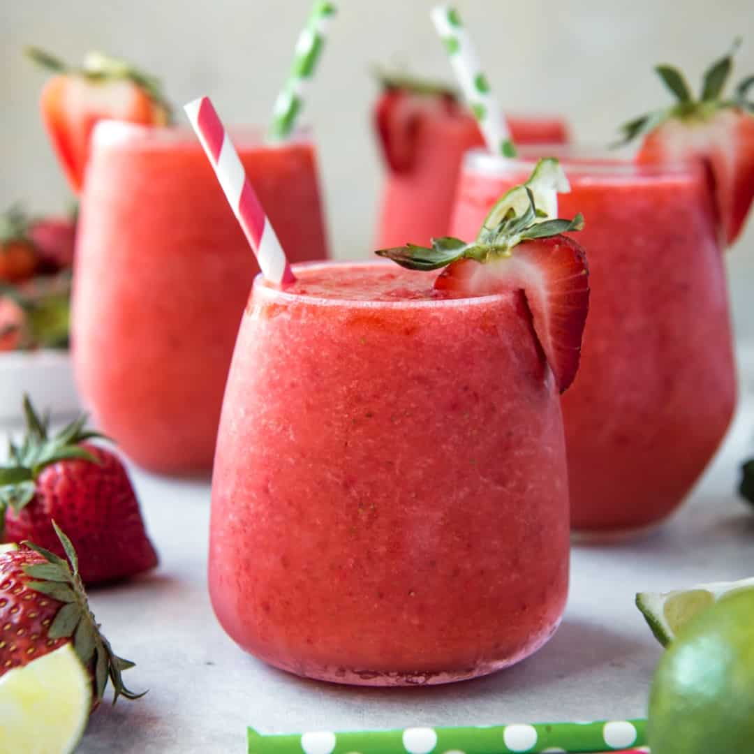 Cold and refreshing, this Strawberry & Lime Moscato Wine Slushie is a summertime sipper's dream! Sweet strawberries are blended with fresh tart lime juice and a healthy dose of Moscato for a fantastic summer cocktail!
