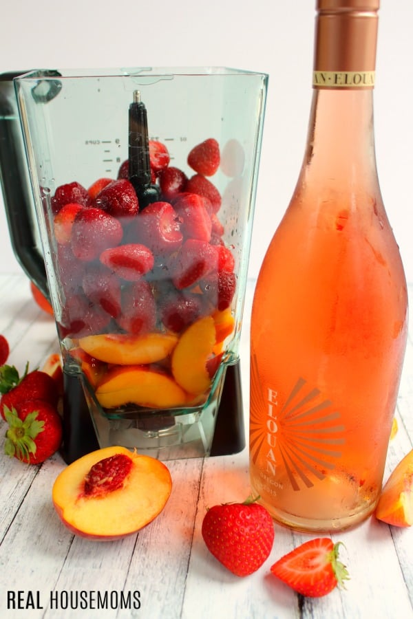 Ingredients to make Strawberry Peach Frosé in a blender