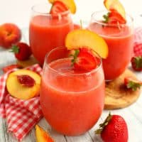 Strawberry Peach Frosé will be your new favorite cocktail! Made with rosé wine, this easy, blended drink is an amazing libation to share with friends on a warm summer night!