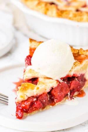 Homemade Strawberry Pie with a Flaky Pie Crust and tons of juicy berries.