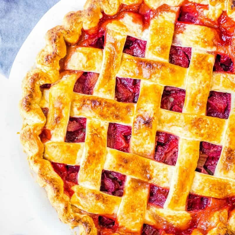 Strawberry Rhubarb Pie is sweet, tart & delicious with a scoop of vanilla ice cream. Learn all my tips for the perfect pie every time!