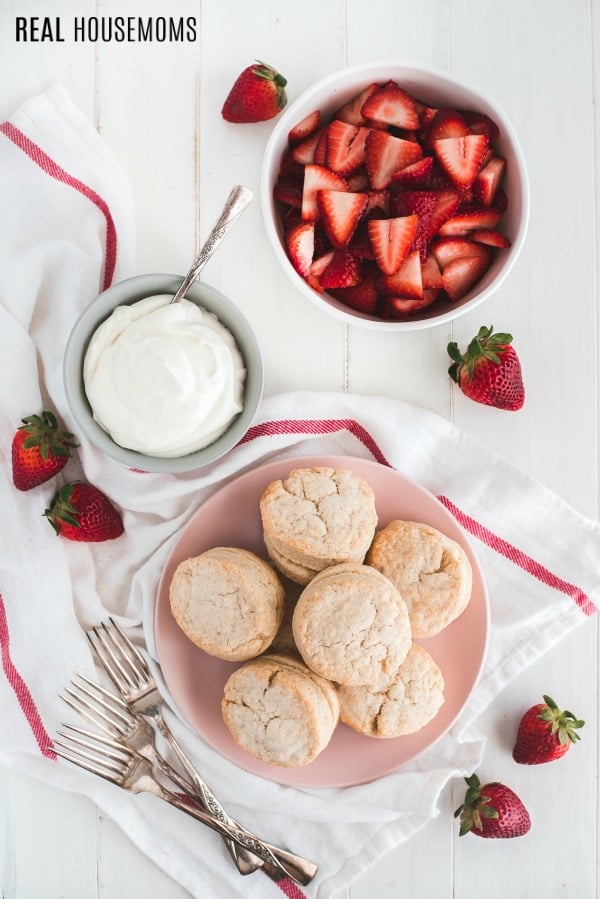 shortcakes, whipped cream, and sliced strawberries for strawberry shortcake
