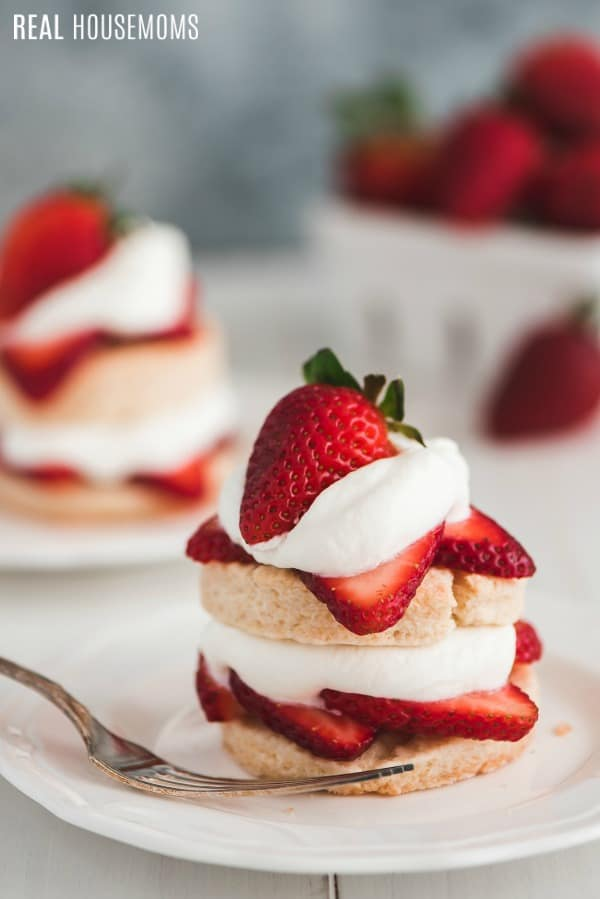 strawberry shortcakes on dessert plates with a fork