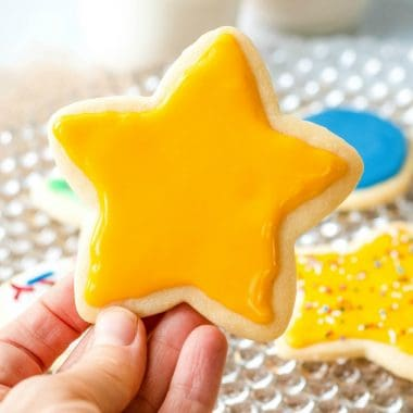 It takes only four ingredients and 5 minutes to make the absolute best cut out Sugar Cookie Icing that hardens to a glossy, shiny surface!