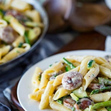 A creamy, flavorful cream sauce, a top penne, with summer sausages and your favorite green summer vegetables. This CREAMY SUMMER VEGGIE & SAUSAGE PENNE is sure to be a hit!