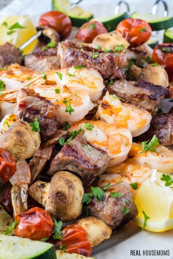close up of surf and turf kabobs on a serving platter