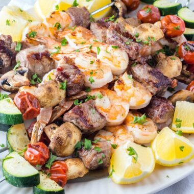 Take your grilling game to the next level Surf and Turf Kabobs! Loaded with veggies, hearty steak & succulent shrimp, they'll be a hit at all your cookouts!