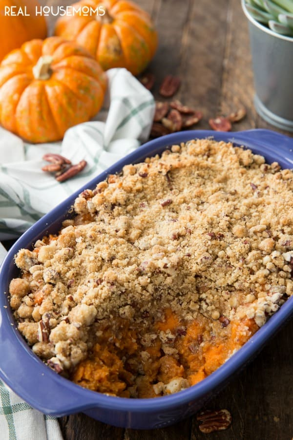 Sweet Potato Casserole is a serving dish with a scoop taken out.
