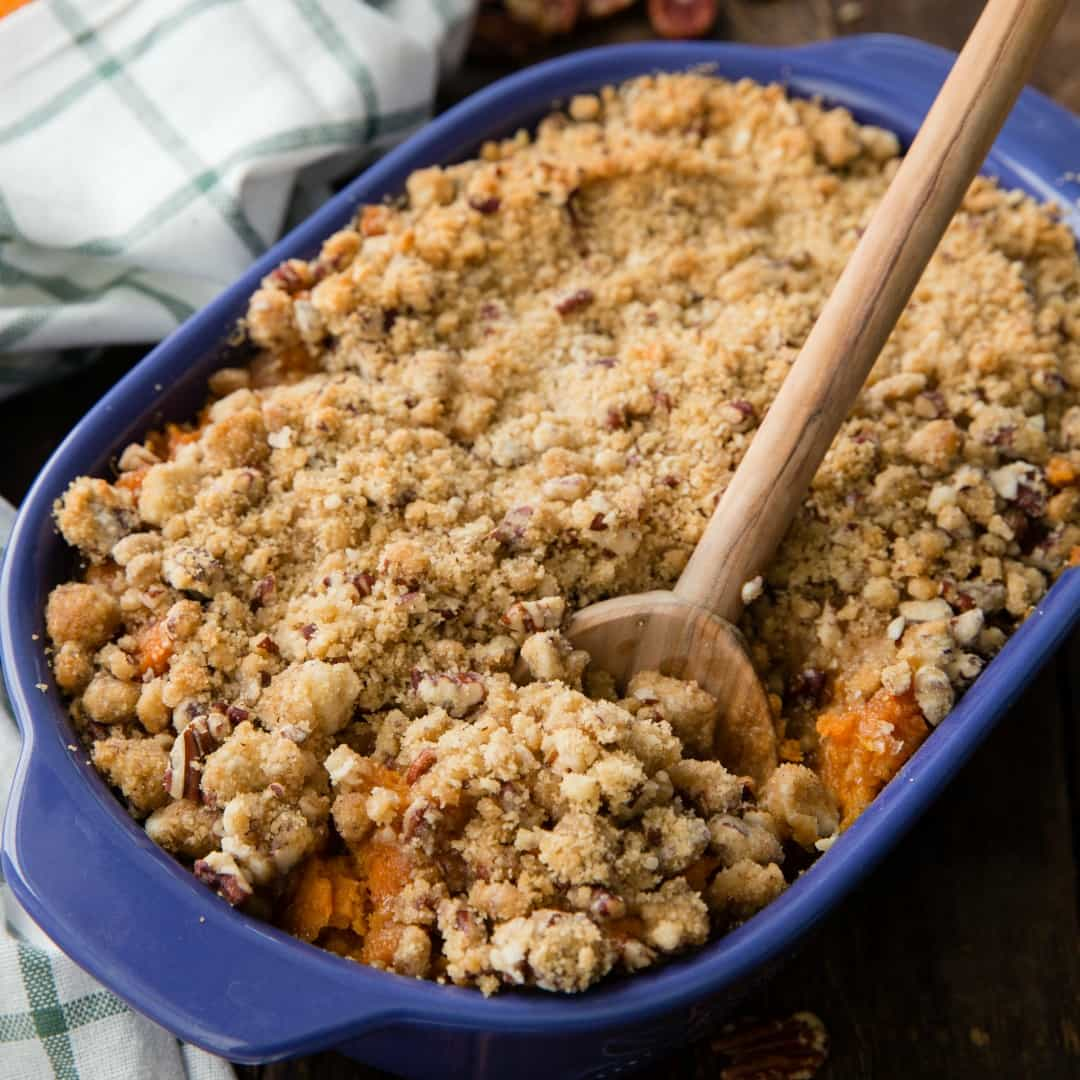 Easy Sweet Potato Casserole has creamy, spiced sweet potatoes topped with a pecan brown sugar streusel. It's the perfect side dish for any holiday meal!