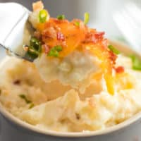 Cheesy, loaded with bacon, and individually portioned - Mini Twice Baked Potato Casserole are the best way to serve mashed potatoes to a crowd!