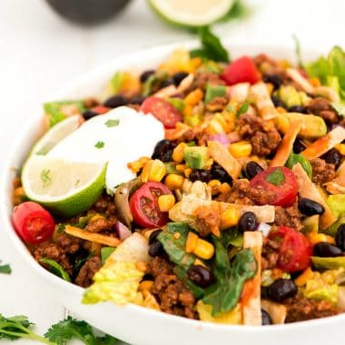 Taco Salad is a summer staple at our house. This easy meal is full everything your favorite tacos while helping you get in more greens!