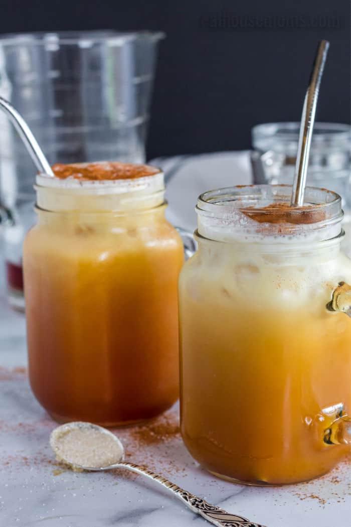 glasses of thai iced tea with cinnamon and straws