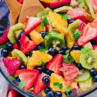 Bold, beautiful, and delicious are only a few ways to describe The Best Fruit Salad Recipe you will make.  The flavors of all the fruit mixed with fresh mint and sprinkled with a little brown sugar are sensational!