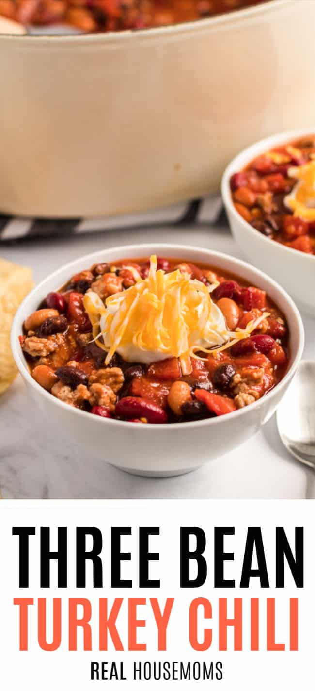 turkey chili in a bowl with sour cream and cheese