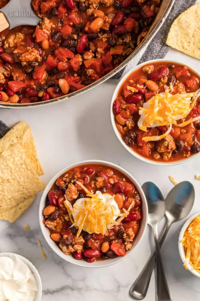 turkey chili served in bowls with spoons