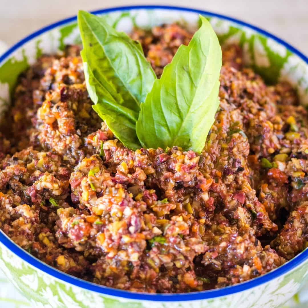 Three Olive Tapenade is delicious, full of amazing flavors, and very addicting! It's a perfect make-ahead appetizer for any occasion!