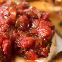 Tomato Jam is a simple appetizer recipe that can be used for any occasion! Serve it up while watching the game, cocktails with friends or the holidays!
