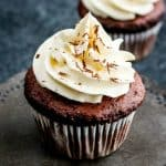 These decadent Triple Chocolate Cupcakes are filled with a creamy chocolate ganache and topped with a luscious white chocolate frosting!