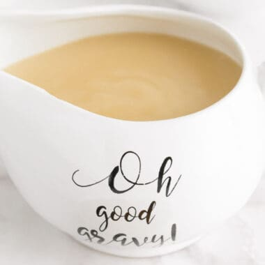 "square image of turkey gravy in a gravy boat with ""oh good gravy!"" on the side"