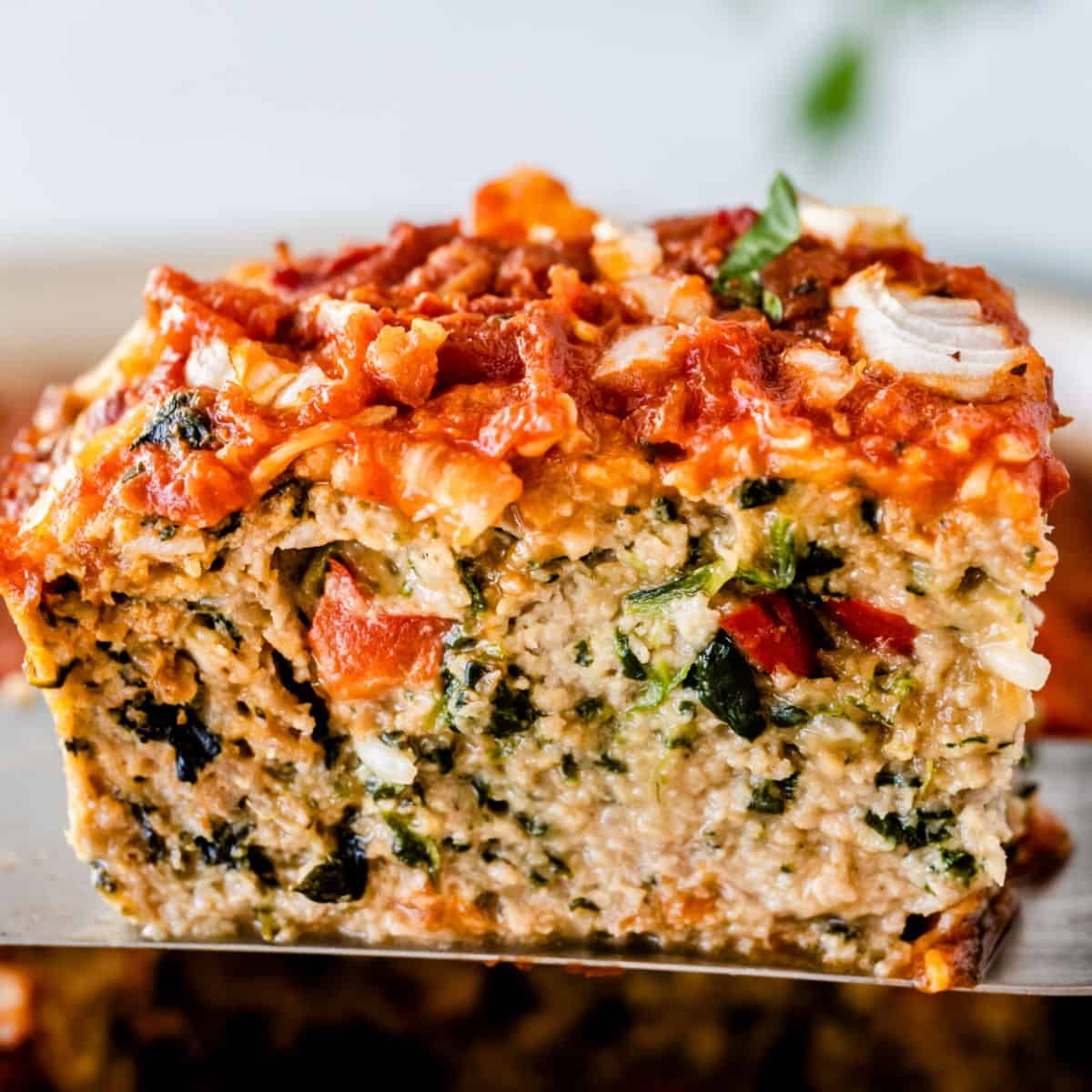 square image of a slice of turkey meatloaf on a spatula