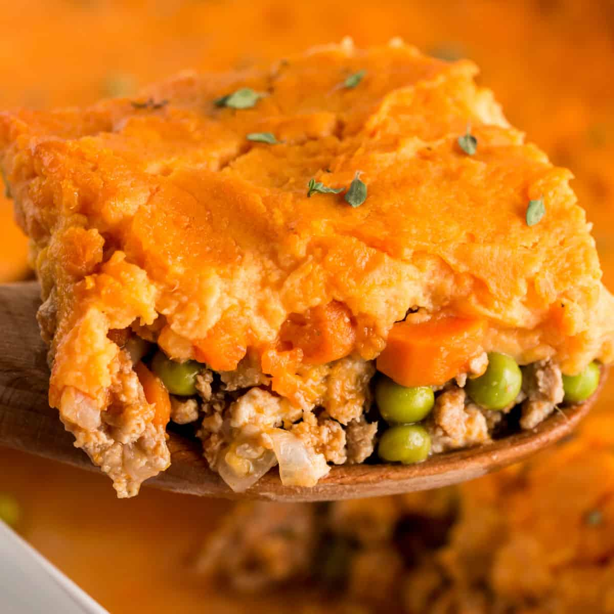square image of portion of Turkey & Sweet Potato Shepherd's Pie on a wooden spatula