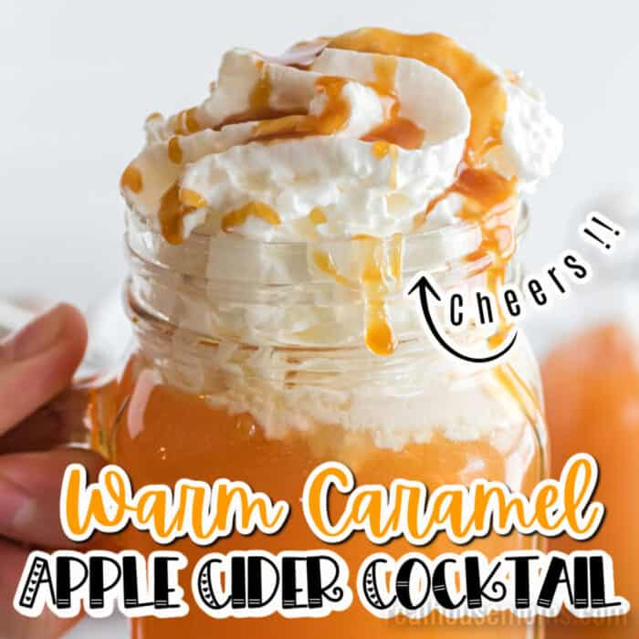 square image of close up of warm caramel apple cider cocktail in a mason jar