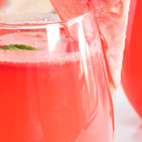 Close up of Watermelon Sangria in a glass with a slice of watermelon