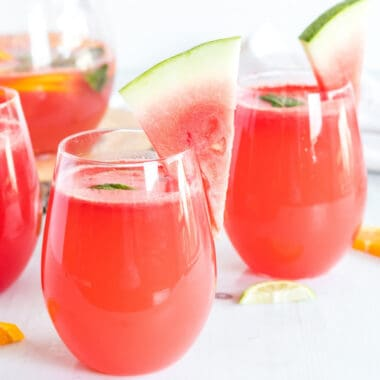 Watermelon Sangria is one of my favorite sangria recipes for the summer! Made with fresh watermelon, oranges, and limes, it's a refreshing, tasty cocktail!