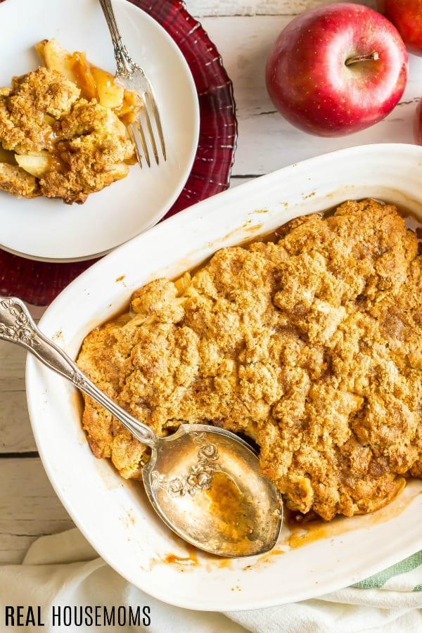 Weight Watchers Apple Cobbler served on a dessert plate along side the baking dish of cobbler with a serving spoon