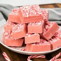 White Chocolate Peppermint Fudge is a super easy recipe that tastes out of this world good! Creamy white chocolate mixed with peppermint is always a hit at Christmas!