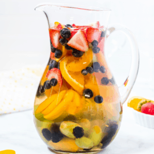 Whether you're lounging by the pool, entertaining friends, or just relaxing after work, you'll want this White Peach Sangria by your side!
