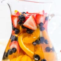 sangria in a pitcher with fresh fruit