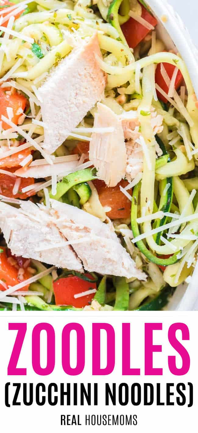 close up of a bowl of zoodles with chicken, bell pepper, and parmesan cheese
