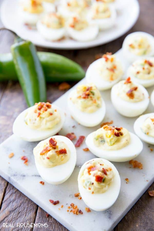 Bacon Jalapeno Deviled Eggs are a delicious dish that adds a kick to the traditional spring, summer, or Easter appetizer!