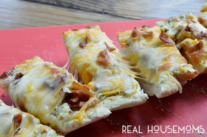 If you are in need of a quick and easy snack or appetizer, this Bacon Ranch Cheesy Bread is it! This bread is loaded with bacon, ranch flavor and tons of cheese! It is great for parties or game day!