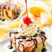 This BANANA SPLIT POKE CAKE will be the most fun dessert you'll make all summer! Layers of chocolate, vanilla, strawberry, banana, and the list goes on! Your family will beg you to make it again!
