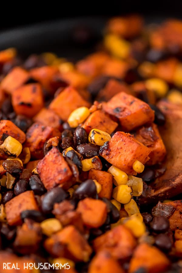 Close up of the filling for Black Bean and Sweet Potato Enchiladas being cooked in a skillet