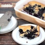 Sweet batter topped with vibrant blueberries make this easy BLUEBERRY COBBLER perfect for any brunch, or top it with a scoop of vanilla ice cream for a delicious dessert!