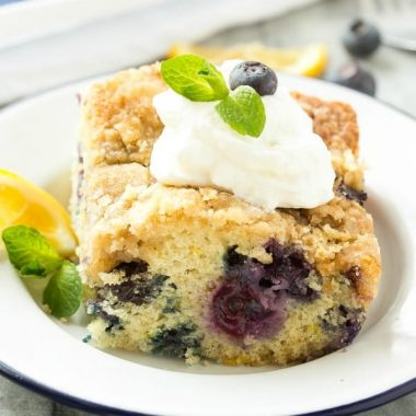 This buttery BLUEBERRY LEMON COFFEE CAKE is bursting with fresh berries and finished off with a crumble topping. It's the perfect addition to any brunch menu!